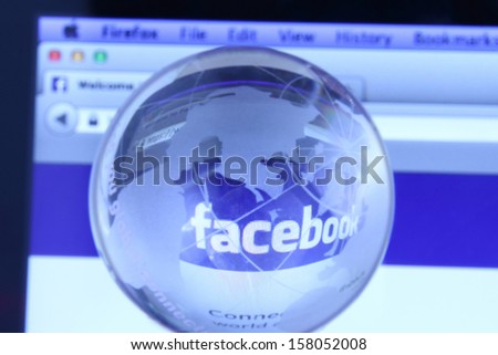 Johor, Malaysia - Sep 6, 2013: Photo of Facebook webpage with glass globe. As of today, Facebook is the largest social media network on the web, Sep 6, 2013 in Johor, Malaysia.  - stock photo