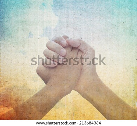 join hand or hand shake on vintage background. - stock photo