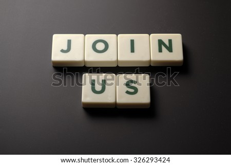 Join Us word tiles on chalkboard, business conceptual - stock photo
