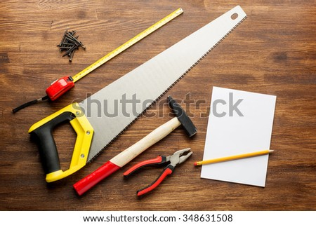 joinery tools on wood table background with note book and copy space. - stock photo