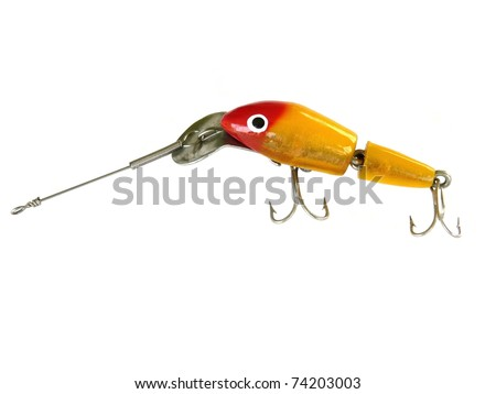 """Jointed or """"injured"""" fishing lure from the 1960s or 1970s. Color is redhead gold with a 3-D flash finish. - stock photo"""