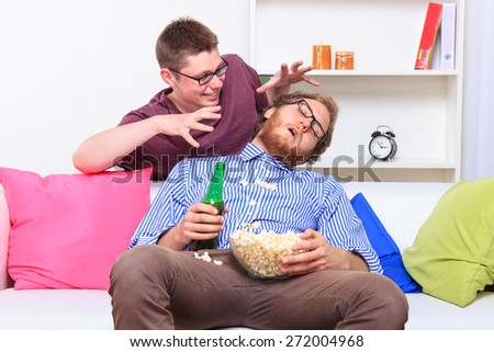 Joke at a party when guy is sleeping  - stock photo