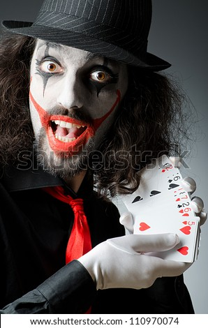 Joker with cards in studio shoot - stock photo