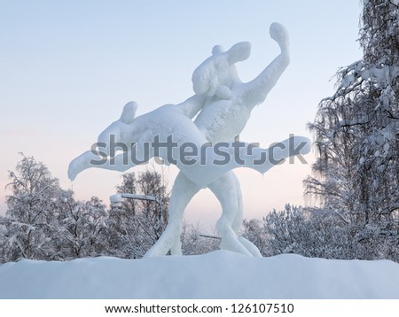 JOKKMOKK, SWEDEN - DECEMBER 27: Dancing elks - the ice sculpture on December 27, 2012 in Jokkmokk, Sweden. The sculpture was made by american snow and ice sculptor Tim Linhart. - stock photo