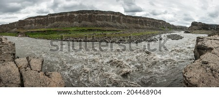 Jokulsa a Fjollum is a very powerful glacier river on Iceland. Two most powerful Icelandic waterfalls Detifoss and Hafragilsfoss are located on it. Panorama - stock photo