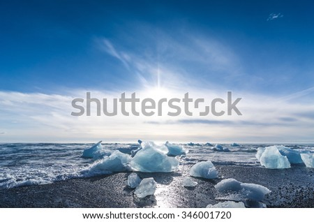 jokulsarlon beach with icebergs, iceland - stock photo