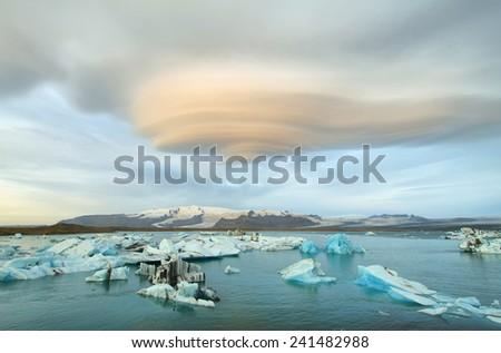 Jokulsarlon Glacial Lagoon of Vatnajokull glacier under majestic lenticular clouds, Iceland - stock photo