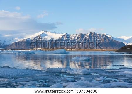 Jokulsarlon ice lake with snow mountain background, Iceland - stock photo
