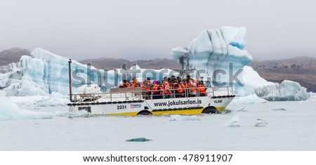 JOKULSARLON, ICELAND - JULY 21, 2016: Jokulsarlon Glacial Lagoon Boat Tour in Iceland on July 21, 2016. Many people visit the famous glacial lagoon in Iceland every year.