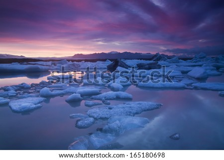 Jokulsarlon is a large glacial lake in southeast Iceland, on the borders of Vatnajokull National Park./ Colorful Jokulsarlon - stock photo