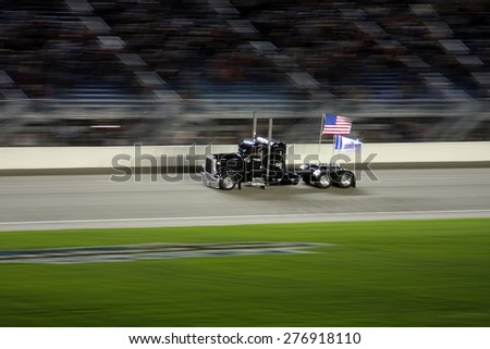 Joliet Illinois, USA - August 29, 2009: IndyCar Racing League. Pre-race semi-truck, drive by with American Flag, Chicagoland speedway. - stock photo