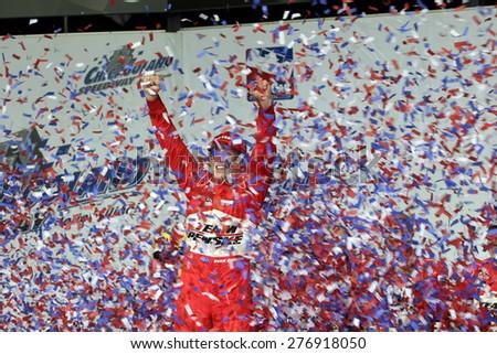 Joliet Illinois, USA - August 29, 2009: IndyCar Racing League. Victory Circle with Ryan Brisco, race winner. Penske racing team, Chicagoland speedway.  Peak Antifreeze & Motor Oil Indy 300 - stock photo