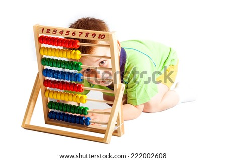 jolly baby boy with abacus isolated on white background - stock photo