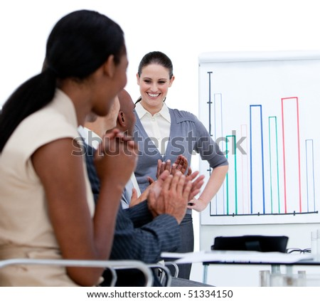 Jolly business team applauding in a meeting in a company