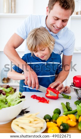 Jolly father and his son cooking at home