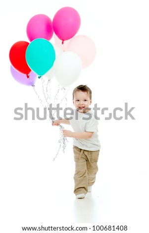 Jolly funny child boy with bunch of colourful balloons in his hand. Isolated on white. - stock photo