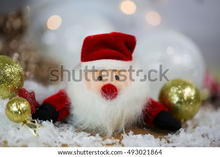 jolly little Santa Claus with Christmas balls and stars