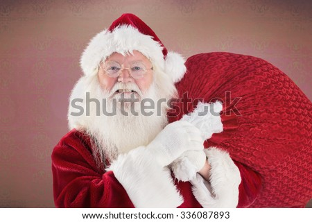 Jolly Santa carries his sack against room with wooden floor