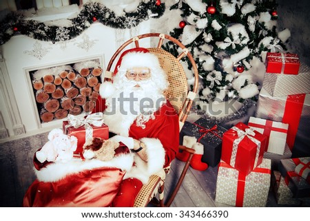 Jolly Santa Claus brought the sack with gifts. Christmas interior decoration. Merry Christmas. Retro style. - stock photo
