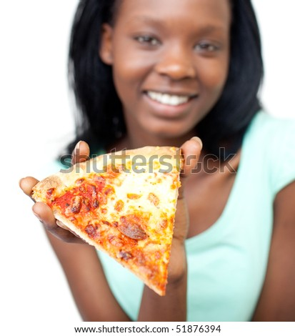 Jolly teen girl holding a pizza against a white background