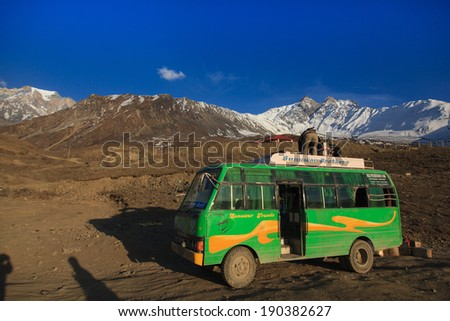 JOMSOM, NEPAL - CIRCA APRIL 2014: Local bus is the primary means of transport in the village of Jomsom circa April 2014 in Jomsom.