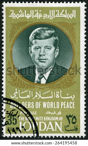 JORDAN - CIRCA 1967: A stamp printed in Jordan shows Portrait of John F. Kennedy (1917-1963), circa 1967 - stock photo