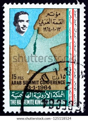 JORDAN - CIRCA 1964: a stamp printed in the Jordan shows King Hussein and Map of Jordan and Israel, circa 1964 - stock photo