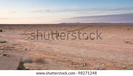 jordanian desert at pink sunset, Jordan - stock photo