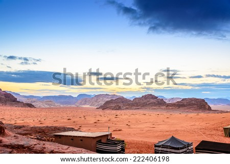 Jordanian desert at twilight in Wadi Rum, Jordan.  Wadi Rum is known as The Valley of the Moon and UNESCO World Heritage Site. - stock photo