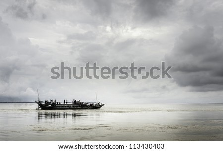 JORHAT - AUGUST 23: traditional ferry boat crosses the river Brahmaputra from Majuli island to Jorhat on August 23, 2011 at Jorhat, Assam, India.