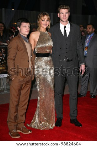 Josh Hutcherson, Jennifer Lawrence and Liam Hemsworth arrive at the European Premiere of 'The Hunger Games' at the O2 Arena, London. 14/03/2012 Picture by: Alexandra Glen / Featureflash - stock photo