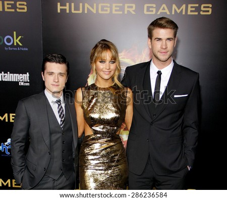 Josh Hutcherson, Jennifer Lawrence and Liam Hemsworth at the Los Angeles premiere of 'The Hunger Games' held at the Nokia Theatre L.A. Live in Los Angeles on March 12, 2012.  - stock photo
