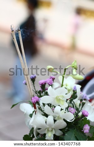 joss stick and flowers