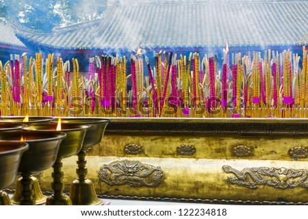 Joss sticks in a temple near the Giant Buddha in Leshan, Sichuan Province, China - stock photo