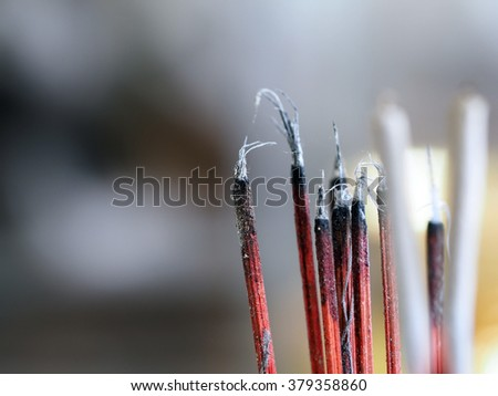 Joss sticks incense burning closeup