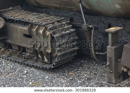 Jot asphalt gush out of asphalt paver machine