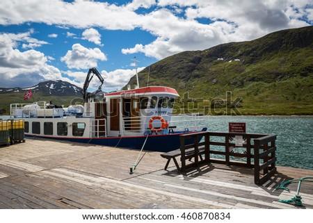 JOTUNHEIMEN, NORWAY-JULY 6: Boat July 6, 2016 in Jotunheimen, Norway. Boat in the norway mountains. - stock photo