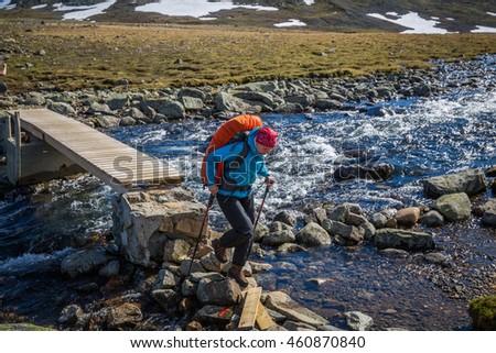 JOTUNHEIMEN, NORWAY-JULY 6: Trackers July 6, 2016 in Jotunheimen, Norway. Trackers in the mountains. - stock photo