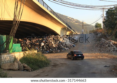JOUNIEH, LEBANON - AUGUST 1: Piling trash in the streets of Lebanese cities shown on 1 August 2015 in the city of Jounieh. This garbage crisis is behind current demonstrations against the government.