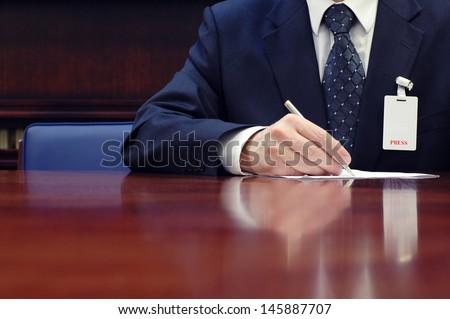 Journalist is doing paperwork at the conference, press concept, business concept.