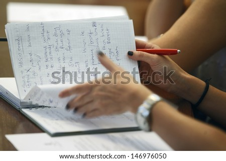 Journalist is taking notes during a conference - stock photo