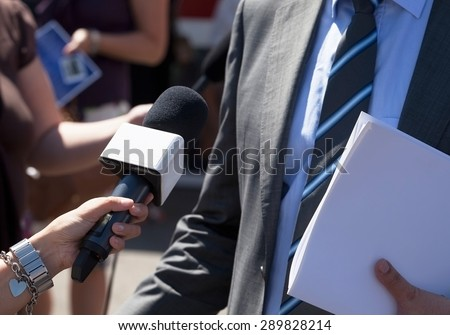 Journalist making interview with businessman - stock photo