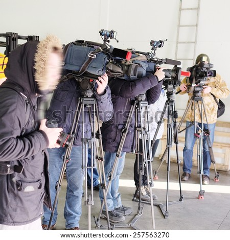Journalists from different of channels taking an interview - stock photo
