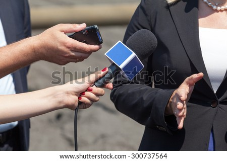Journalists making interview with business woman - stock photo
