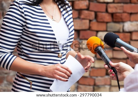 Journalists making interview with woman - stock photo