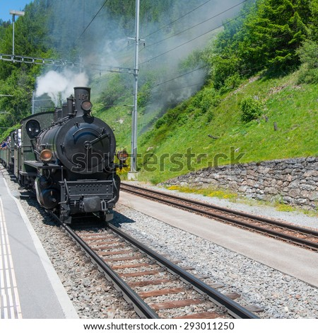Journey by the historic steam  train to Grisons, Swiss Alps - stock photo