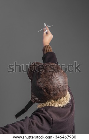 journey, child playing the aircraft pilot with hat and retro bomber jacket - stock photo