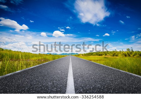 journey concept with long road with green field and blue sky illustration