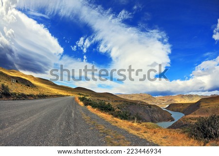 Journey into a far country. The gravel road on the bank of the river and the incredible ice clouds form. The picture was taken Fisheye lens - stock photo