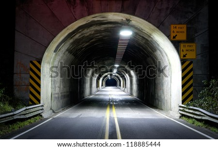 Journey into the long dark tunnel on highway 101 late at night traveling